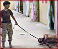 Abu Ghraib - torturer with leash